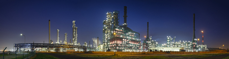 A gigantic oil refinery in the harbor of Antwerp at night. Stock Photo