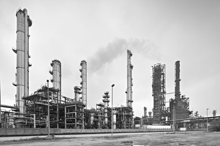 A large oil refinery in the harbor of Antwerp on a gray day. Perspective corrected via lens shift, black and white version.