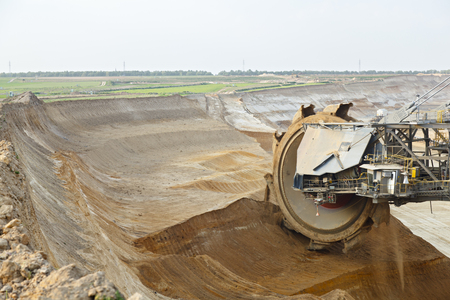 A lignite surface mine with a giant bucket-wheel excavator, one of the worlds largest moving land vehicles. The diameter of the wheel is around 12 meters or 40 foot.
