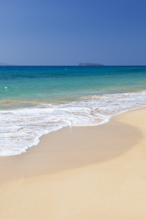 The perfect Makena Beach in Maui, Hawaii. The island in the background is Molokini. Stock Photo
