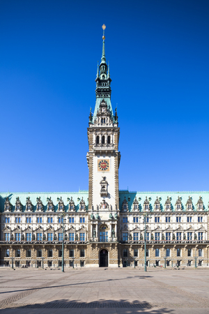 Full frontal and straight perspective shot of the historic town hall of Hamburg, Germany.