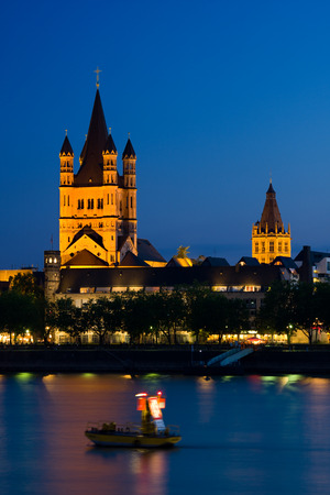 Night view over the rhine river to Great St. Martin Church in Cologne, Germany.