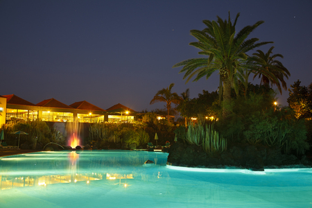 Hotel landscape at night in Los Cancajos, La Palma. A fountain in the background. Stock Photo