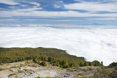 View from the Pico de la Nieve in La Palma, Spain to Tenerife floating on clouds.