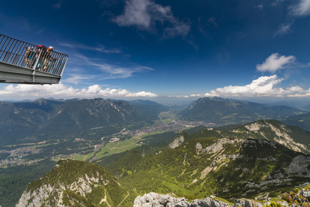 GARMISCH - JULY 07: Some tourists on the Alpspix Observation Platform on the Osterfelder Kopf with view to Garmisch-Partenkirchen, Germany on July 07, 2016. Editorial