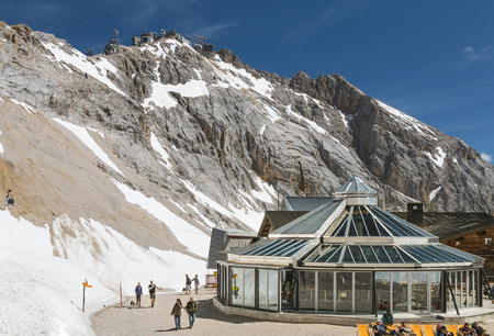 GARMISCH - JULY 04: The Restaurant Zugspitzplatt on the Zugspitze, Germany with some tourists around on July 04, 2016. Editorial