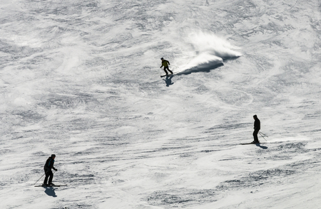 SOELDEN - MARCH 22: Skiers on the black run of the Gaislachkogel in Austria against the sunlight on March 22, 2016.