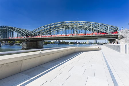 COLOGNE - SEPTEMBER 6: The new Rhine River promenade in front of the Hohenzollern Bridge in Cologne in Germany on September 6, 2016