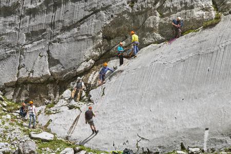 GARMISCH - JULY 07: Tourists learning how to climb a small rock wall near Garmisch-Partenkirchen, Germany on July 07, 2016. Editorial