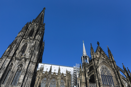 Cologne Cathedral low angle view from the side with blue sky