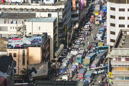 Nairobi, Kenya - December 23: Work and Christmas traffic with Matatus during rush hour on Ronald Ngala Street in Nairobi, Kenya on December 23, 2015