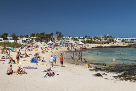 FUERTEVENTURA - SEPTEMBER 20: Tourists enjoying the day at a Corralejo City beach in Fuerteventura, Spain on September 20, 2015 Editorial