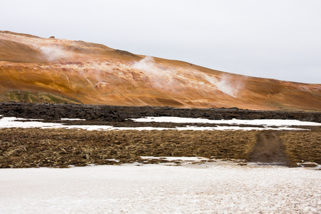 Snow in the geothermal active region near Leirhnjukur in Iceland.