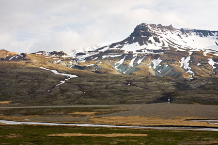 In the east of Iceland the main road 1 leads up to its highest pass through the mountains. The image shows the view to the southeastern valley.