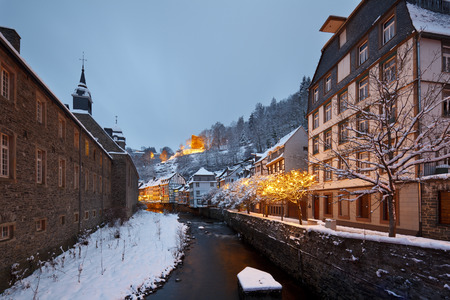 The river Rur in the German Eifel village of Monschau during christmas time at night, Germany.