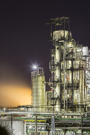 Oil refinery distillation towers at night. Stok Fotoğraf