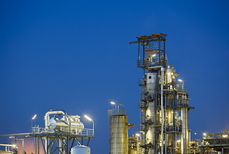 A chemical plant and refinery detail shot at night. Stok Fotoğraf