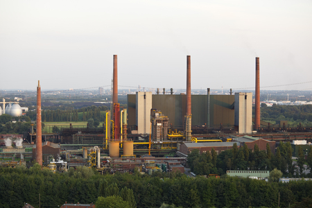 Smoke Stacks and other buildings of a large coking plant with evening light.