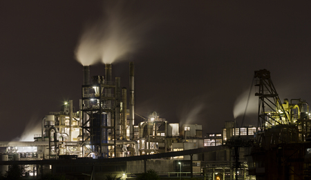 Night shot of chemical plant with a lot of steam. Editöryel