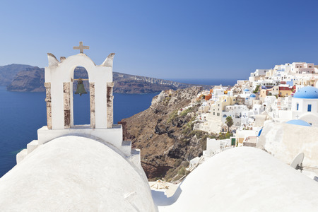 Oia with some chapels, view from the center to the west in Santorini.