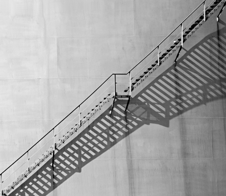 Staircase on an oil storage tank in sunlight. Stok Fotoğraf