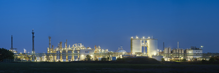 Panoramic shot of a chemical plant during blue hour. Stock Photo
