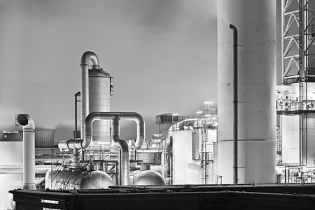Chemical plant detail with a lot of steam in black and white.