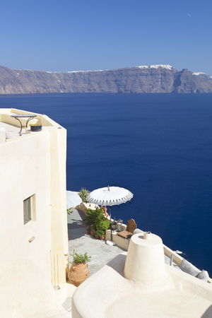 A terrace in Oia with view to the crater rim in Santorini.