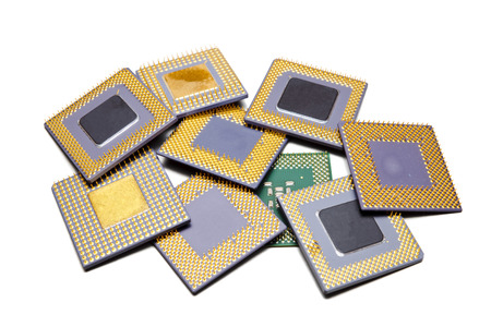 Lots of different old CPUs on a heap isolated on white.