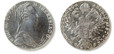Front and back of a Maria Theresa Thaler (Maria Theresia Taler) coin, isolated on white. The coin is made since 1741 mostly in Austria.
