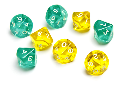 Ten sided dices (d10) translucent in green and yellow. Stock Photo