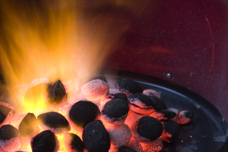 Burning charcoal in a grill.