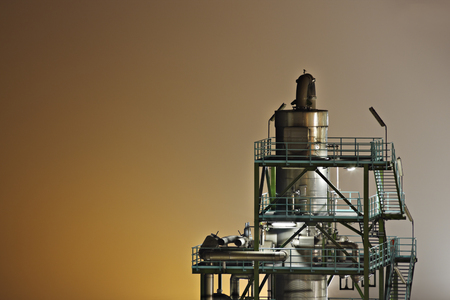 Night shot of a distillation tower isolated on steamy background. Stok Fotoğraf
