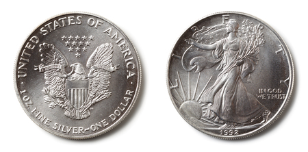 Front and back of a United States Silver Dollar, isolated on white. Stock Photo