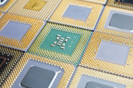 Close-up shot of different old CPUs between 486 and 686 class. Stock Photo