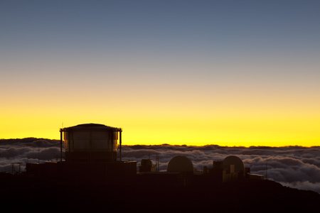 Sunset view to the observatories on top of the Haleakala in Maui, Hawaii.