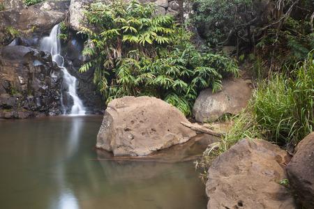 Long exposure shot of a little waterfall in Waimea Canyon in Kauai, Hawaii.