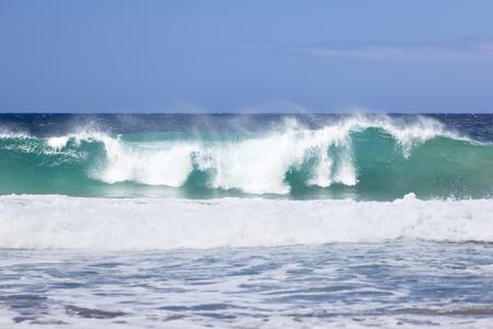 Tall waves at the Na Pali Coast in Kauai, Hawaii. Stock Photo
