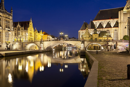 Nighttime long exposure shot of the famous canal with Saint Michaels Bridge at Graslei in Ghent, Belgium.