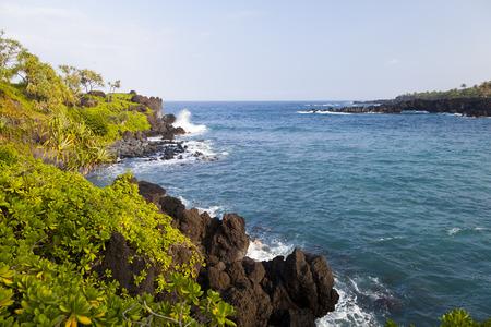 Waves splashing on cliffs in eastern Maui, Hawaii.