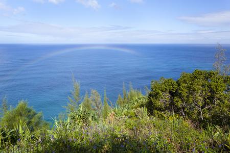 A rainbow just from the surf at the Na Pali Coast in Kauai, Hawaii.