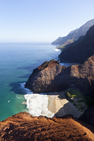 View from helicopter down to Honopu Beach and Arch at the Na Pali Coast in Kauai, Hawaii. Stock Photo