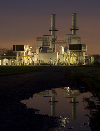 Gas compressor station as part of a chemical plant in Rheinberg, Germany with reflection. Stok Fotoğraf