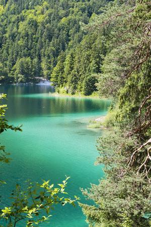 Clear turquoise water at lake Eibsee near the Wetterstein in Garmisch-Partenkirchen, Germany in summer.