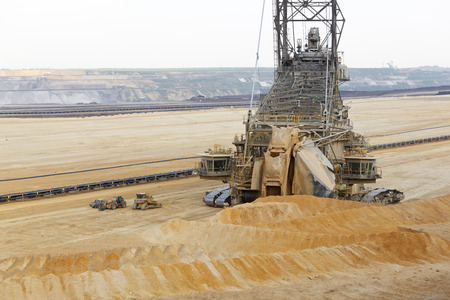 A lignite pit mine with a giant bucket-wheel excavator, one of the worlds largest moving land vehicles. The little cars and construction vehicles show the scale.