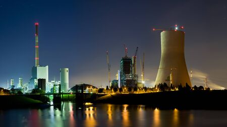 Panoramic night shot of an old coal power station and a new one under construction at night. Duisburg, Germany.