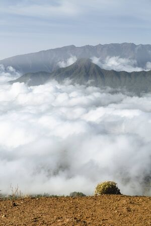 Tradewind clouds moving against the mountains of La Palma between the Caldera de Taburiente in the background and Cumbre Vieja. Seen from the top of the volcano Birigoyo in the evening.