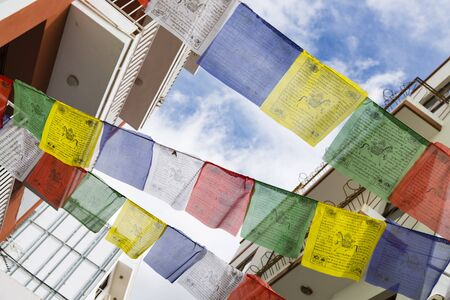 Colorful cloths hanging between houses for a celebration in Los Llanos, La Palma, Spain. Фото со стока