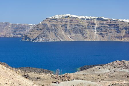 View from Nea Kameni to the crater wall of Santorini, Greece.
