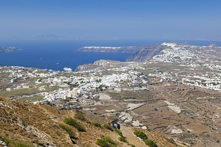 View from the Profitis Ilias over the Santorini caldera with Oia in the background. 写真素材